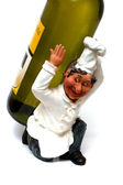 Cook figurine is holding wine bottle — Stock Photo