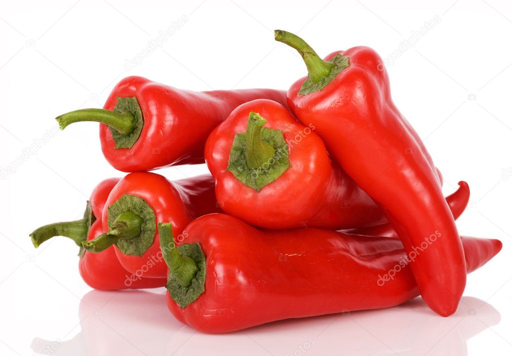 Red peppers with a green pod on a white background — Stock Photo #2974796
