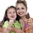 Mother And Daughter eating Ice Cream - Stock Photo