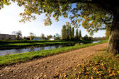 Autumn alley with river — Stock Photo