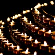 Stock Photo: Candle light in a church