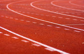 Tracks on red field — Stock Photo