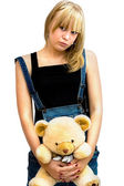 Young girl with a toy bear — Stock Photo
