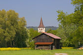 Cabin with Church — Stock Photo