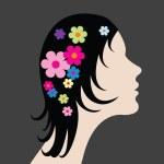 mulher com flores no cabelo — Foto Stock