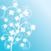 Blue background with white clovers — Stock Photo