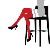 Sexy woman legs staying on a bar chair — Stock Photo