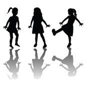 Silhouettes des enfants heureux — Photo