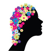 Woman with flowers in her hair — Stock Photo