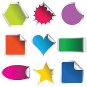 Colored stickers in different shapes — Stock Photo