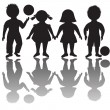 Four children silhouettes with balls — Stock Photo