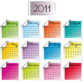 2011 calendar on colored sheets — Stock Photo
