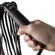 Flogging Whip in woman's hand — Stock Photo