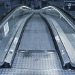 Escalator going down. - Stock Photo