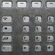 Metallic number pad on a public phone — Stock Photo #2838805
