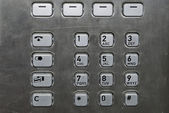 Metallic number pad on a public phone — Stock Photo