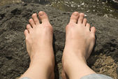 Feet on a stone. — Stock Photo