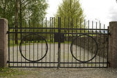 Iron cemetery gate. — Stock Photo