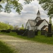 Old cemetery with white Church - Stock Photo