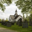 Stock Photo: Antique white Church on Old cemetery.