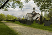 Old cemetery with white Church — Stock Photo