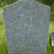 Blank tombstone stands in a cemetery. — Stock Photo