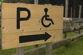 Wooden Permit Parking sign For disabled person. — Stock Photo