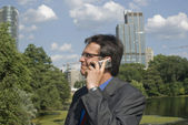 Businessman alking on cell phone — Stock Photo