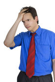 Portrait of stressed businessman touching his head and thinking — Stock Photo