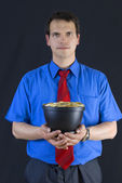 Businessman holding a pot with coins. — Стоковое фото