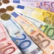 Close-up of the fan Euro banknotes and coins. — Stock Photo #3644698