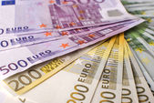 Close-up of the fan Euro banknotes and coins. — Stock Photo