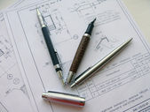 Pens and a pencil on a sheet of paper — Stock Photo