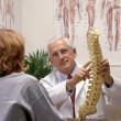 Foto Stock: Chiropractor in his office with patient