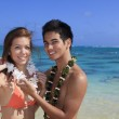 Young couple at the beach in hawaii — Stock Photo