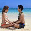 Couple on the beach in hawaii meditating — Stock Photo #2856047