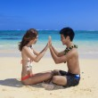 Couple on the beach in hawaii touching — Stock Photo #2856057