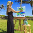 Artist in her fifties painting — Stock Photo