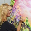 Female artist painting with — Stock Photo #2866890