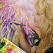 Female artist painting with — Stock Photo #2866911