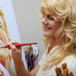 Woman in her fifties painting — Stock Photo