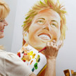 Woman in her fifties painting — Stock Photo #2866949