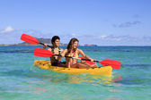 Young couple with a kayak — Stock Photo