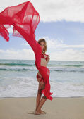Girl in a red bikini and chiffon — Stockfoto