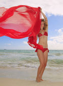 Girl in a red bikini and chiffon — Stok fotoğraf