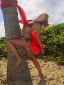 Blond girl in red bikini in Hawaii — Stok fotoğraf