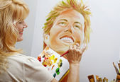 Woman in her fifties painting — Foto Stock