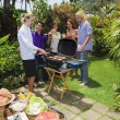 Friends at backyard bar-b-que — Stockfoto #2946537