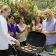 Stock Photo: Friends at a backyard bar-b-que