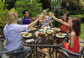 Friends at a backyard bar-b-que — Stockfoto